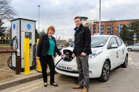 Electric taxi being charged at Watford
